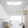 TatoArchitects将家具物品纳入了兵库县伊丹市三层房屋的流通和结构中